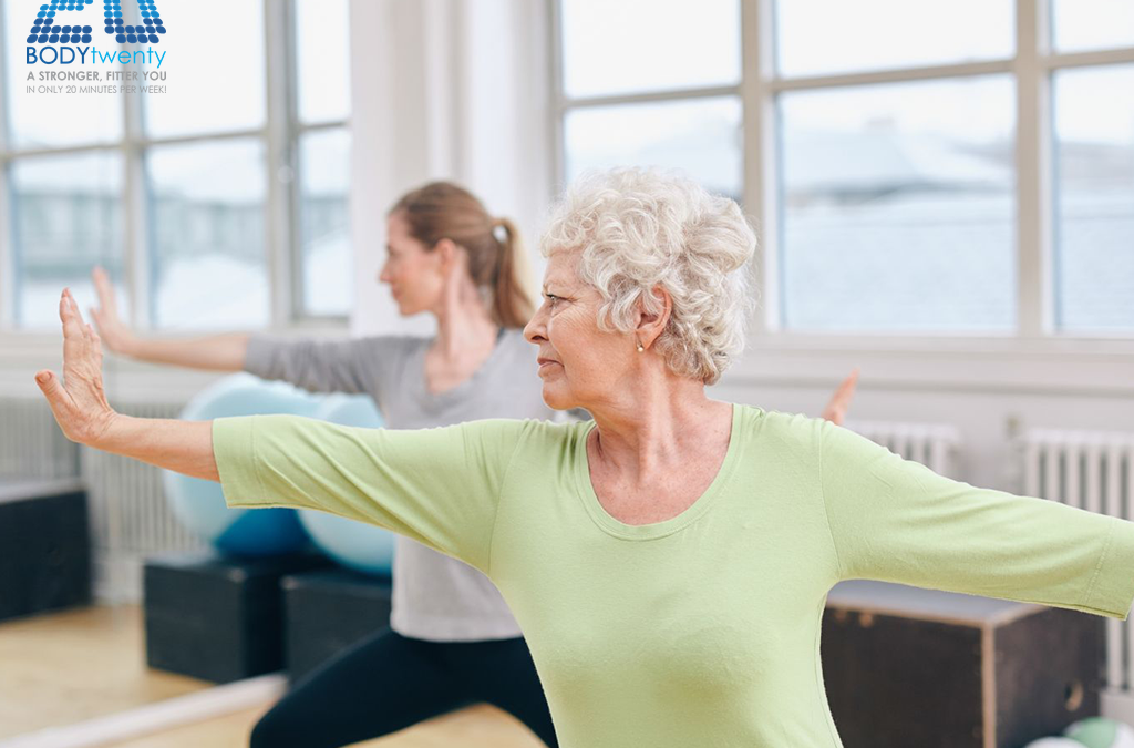 Old woman exercising in studio