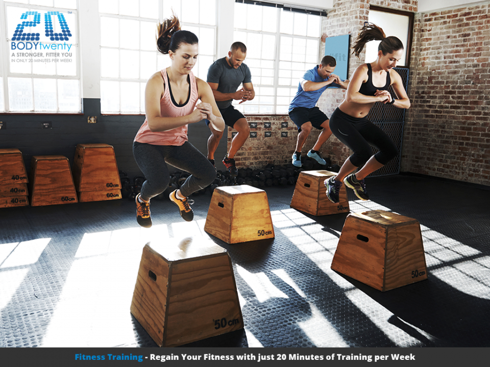 Fitness group indoor workout jumping on wooden boxes